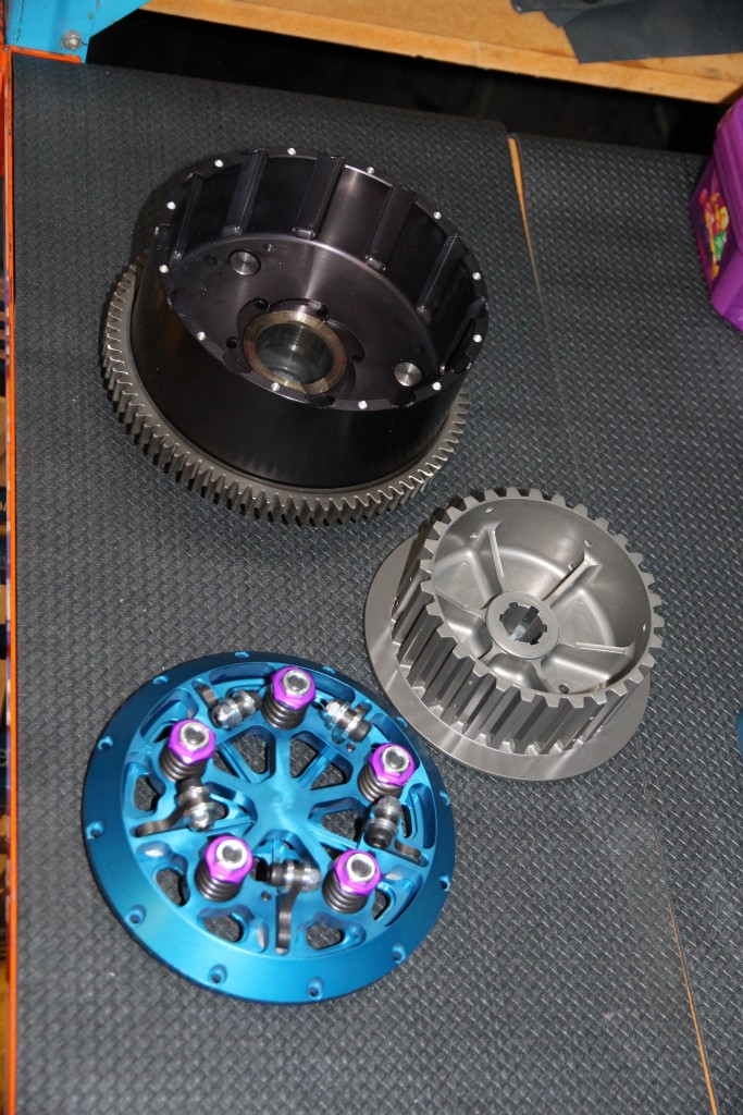 FROM THE TOP: Clutch basket, inner hub and slider hat and pressure plate. Anodised MTC billet goodness.