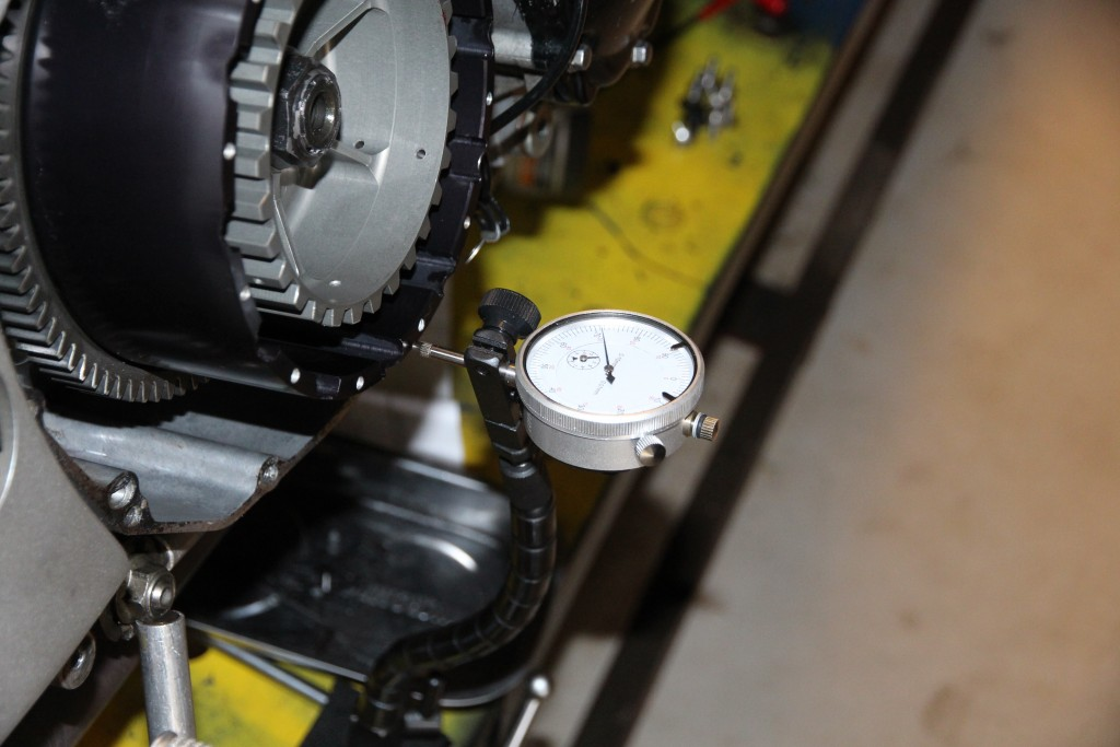 Dial gauge used to measure end float of clutch outer basket.